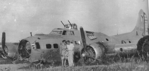 The photograph is of the belly-landed Miss BeHaven, taken in the summer of 1945 at the landing location. The aircraft has been cannibalised. B-17 44-6407 Miss Behaven
