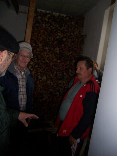 What was once a cell, is now wood storage for the appartments. Bill tells Wolfgang Brossmann about it.