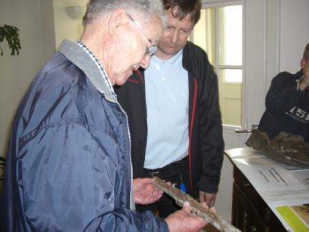 Christian shows Bill parts recovered from one of the two crash sites while touring the display Christian set up in the Church School.