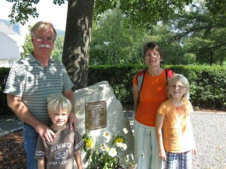The Lilligren family visits the Memorial Plaque for two 32nd Squadron B-17s at the War Memorial in St. Jacob im Walde, Austria.