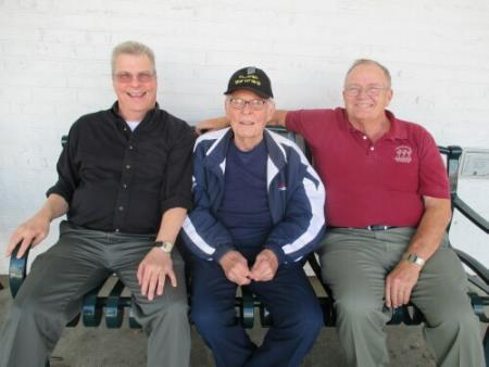 Fred's son, Lynn ( right ) visits with Pilot Thad Crump and son Phillip in Richmond on Veterans' Day 2014