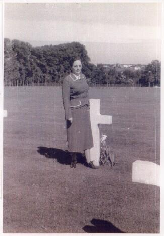 Herbert's older sister Ada Herring Arroya visits his grave site after the War