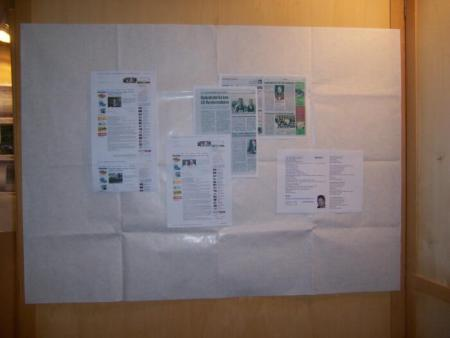 Newspaper articles about the event are displayed