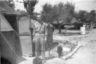 Earl outside of his quarters in Italy - 301st BG, Army Air Corps Library and Museum
