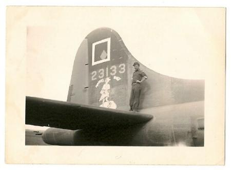 T/Sgt. Simrak stands on the tail of 42-3133, Nobody's Baby - 301st BG, Army Air Corps Library and Museum