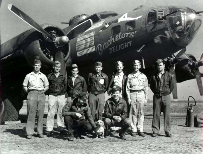 T/Sgt. John W. Terrell is standing 3rd from right. Peter Kliest is kneeling and petting Adolph the mascot Dachshund.  - 301st BG, Army Air Corps Library and Museum