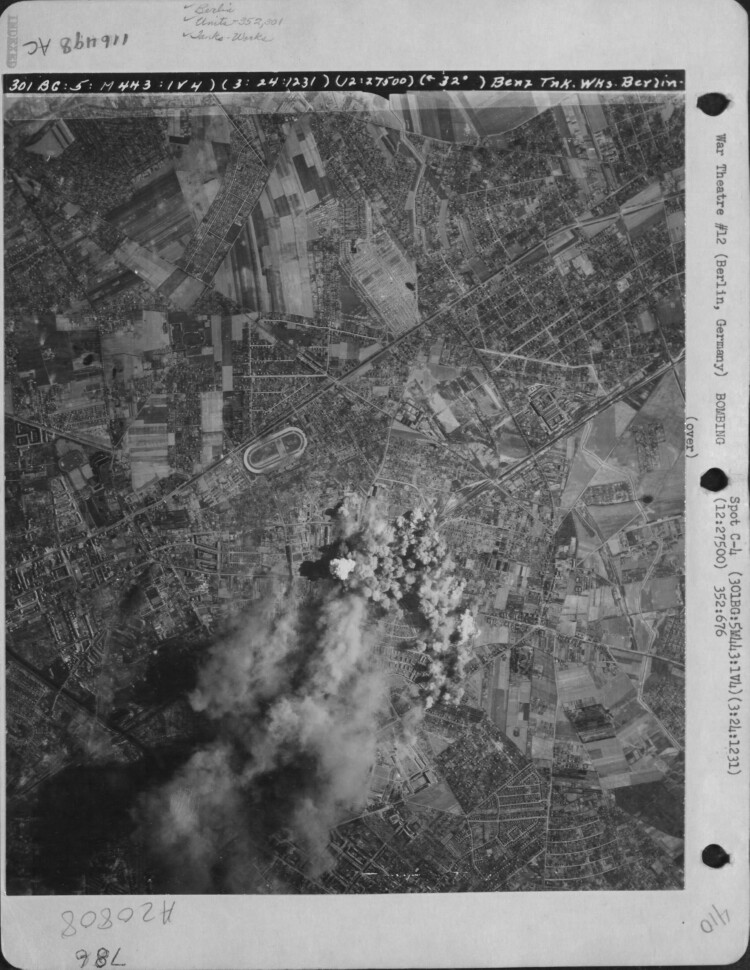 The Benz Tank Works at Berlin, Germany are covered with bomb bursts after a raid by planes of the 352nd Squadron, 301sr Bomb Group on March 24, 1945. 301st Bombardment Group Mission to Berlin  Germany  - TKW on 03/24/1945
