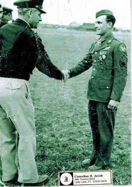 S/Sgt. Cornelius H Jacob receiving his DFC from General Twining.  - 301st BG, Army Air Corps Library and Museum