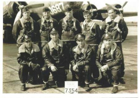 Front Row L to R:  Jay W. Cristy - Pilot;  Floyd R. Byerly - Co-pilot; Carl Bass - Nav.; Joseph F. Gehring - Bomb.