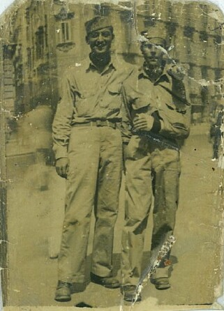 Sgt. John Harris (R) in Naples on leave with a buddy after being wounded on his first mission. - 301st BG, Army Air Corps Library and Museum