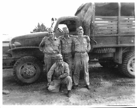 Lt. Howard Ryan kneeling in front with best friend Pfc. Frank Beneduci (far left), with 951st Engr. Topographic Co. in North Africa.  - 301st BG, Army Air Corps Library and Museum
